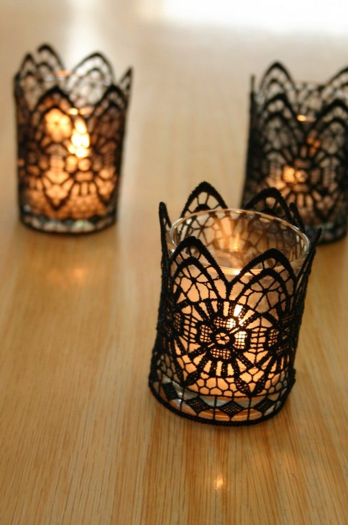 Black lace candles: Simple glass votives are wrapped in black lace trim.