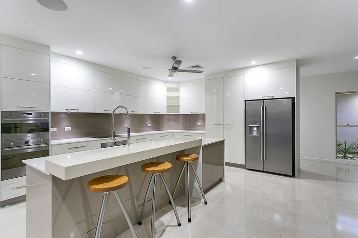 Entrant - Micale Cabinets. Month - August. Products used - essastone frappe – 100mm island feature, essastone crystal chalk – 20mm benchtops and Laminex Metaline Autumn Perle splashback.