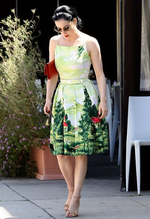 Dita Von Teese in day clothes. I love the sundress with a border print. I might have to make something like this, maybe with a less Alaskan theme.