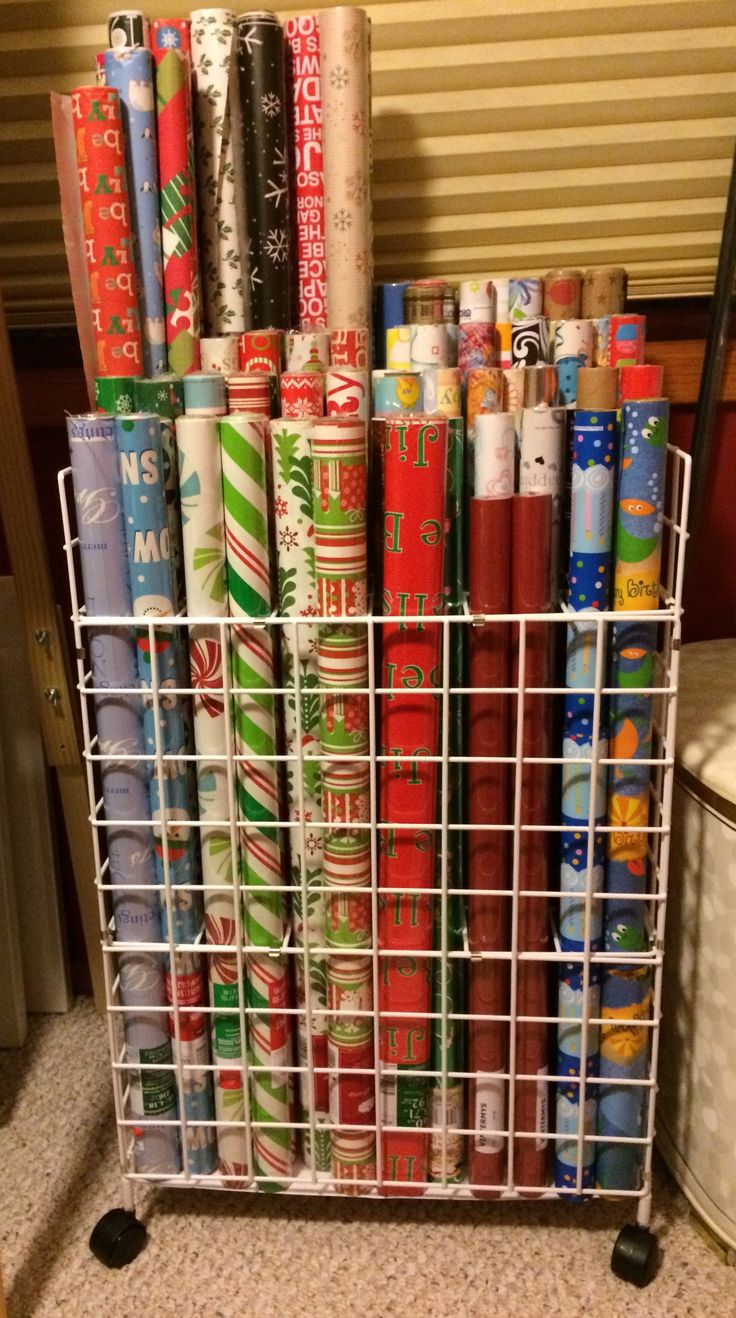 The best wrapping paper storage solution yet! It's a rolled plan file. (usually used for blueprints/architectural drawings)  BONUS: It's mobile! This model holds up to 120 rolls of wrapping paper (rolls like you'd find at Dollar Tree) So glad I thought of this!