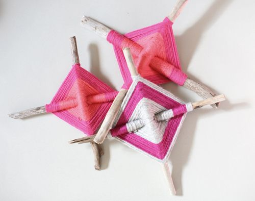 make patterns by weaving wool around sticks or paddlepop sticks, make sure it doesn't overlap as you go around, keep it neat and as close to the previous lap