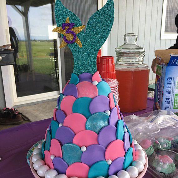 Adorno de torta de cola de sirena  En el partido de mar