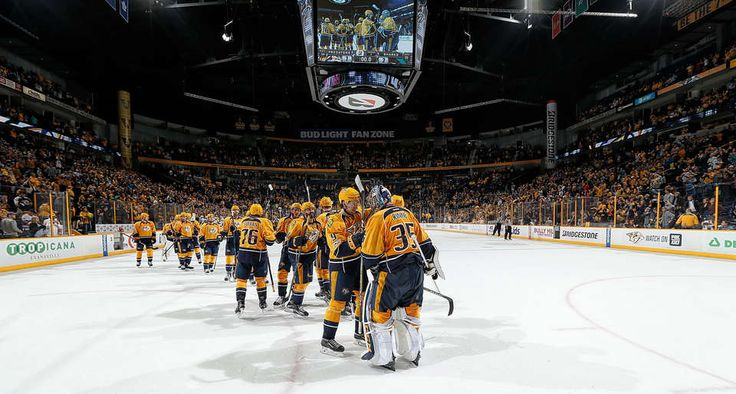 NASHVILLE, TN - MARCH 25: Pekka Rinne #35 is congratulated by Filip Forsberg #9 of the Nashville Predators after a 7-2 win against the San Jose Sharks during an NHL game at Bridgestone Arena on March 25, 2017 in Nashville, Tennessee. (Photo by John Russell/NHLI via Getty Images)