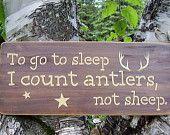Rifles Racks and Deer Tracks Distressed Hunting Sign. $28.00, via Etsy.
