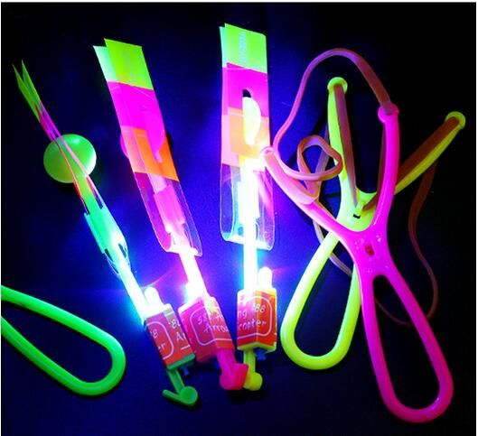 50Pcs or 100pcs  Amazing LED Light Arrow Rocket Helicopter rotating Flying Toy Party Fun Gift Blue light