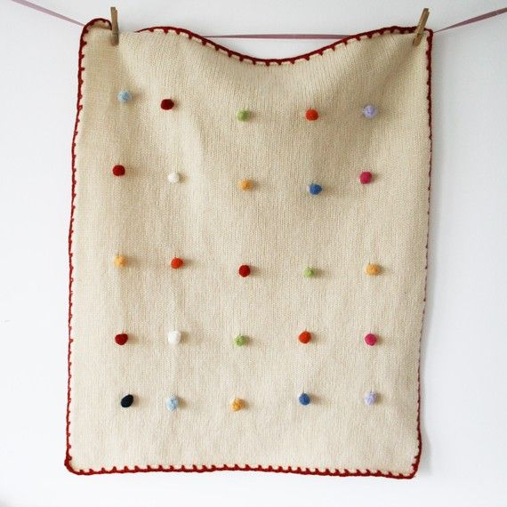 Lambswool blanket with rainbow Bobbles. Very cozy.  Wish it were winter right now!