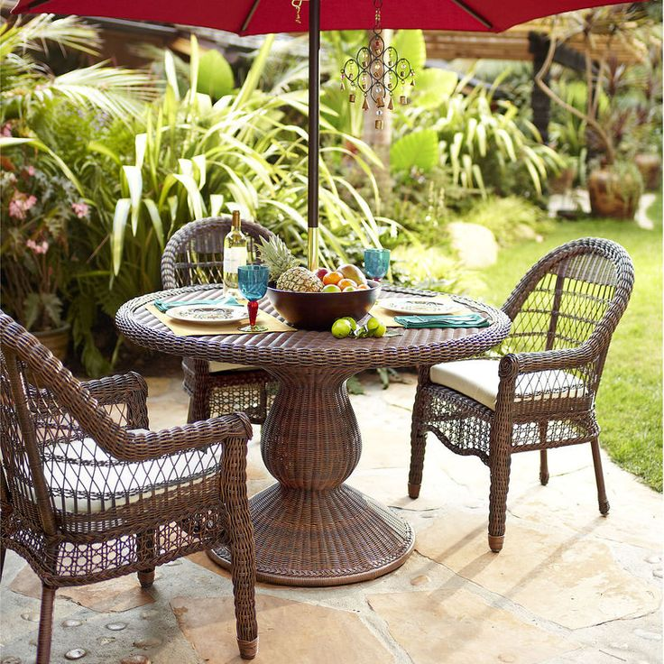 """An airy, exceptionally comfy, traditional outdoor dining chair made of hand-woven synthetic rattan over a durable, durable rust-resistant metal frame. To clean, you literally just hose it off. Pretty delicious, huh? <span id=""""mini-upsell"""" data-launch=""""true"""" data-required=""""false"""" data-product=""""Cushions"""" data-masters=""""PV285-3:1""""></span>"""
