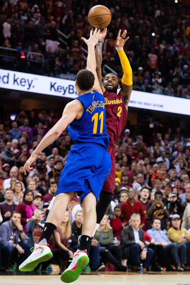 Kyrie Irving #2 of the Cleveland Cavaliers shoots over Klay Thompson #11 of the Golden State Warriors to win the game in the final seconds at Quicken Loans Arena on December 25, 2016 in Cleveland, Ohio. The Cavaliers defeated the Warriors 109-108.