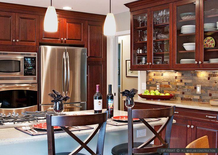 Glass tile backsplash with granite kitchen for Burgundy kitchen ideas