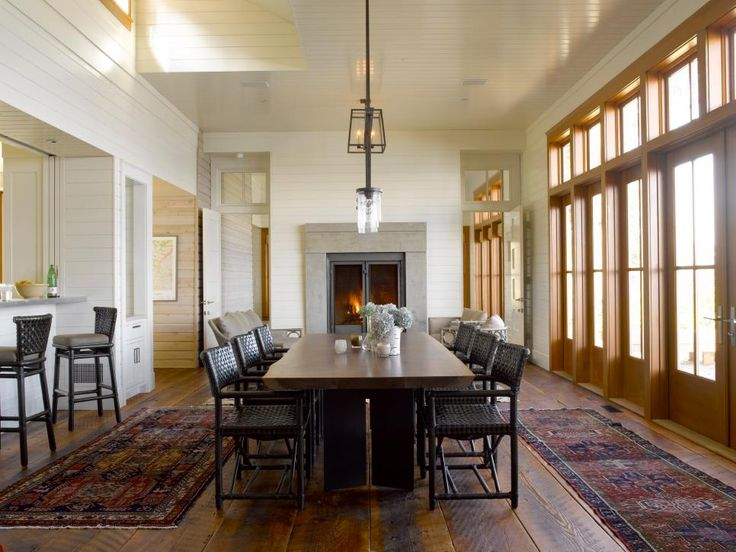 The White Paneled Walls And Ceiling In This Cottage Dining Room Allow Natural Light To Bounce Off Brighten Space Salvaged Plank Wood Floors Are