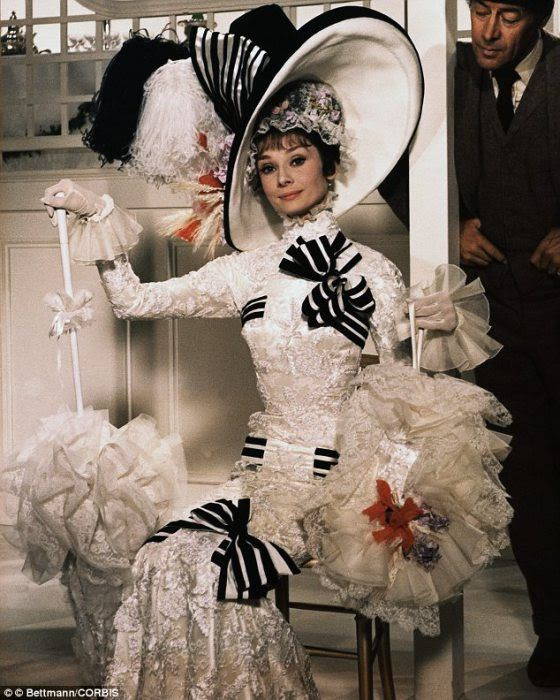 Audrey Hepburn as Eliza Doolittle at the Royal Ascot horse races. In the film, Eliza is every inch a refined English lady until the horserace tightens. Then she erupts in a stream of Cockney speech that threatens to blow her cover as a Covent Garden flower girl.