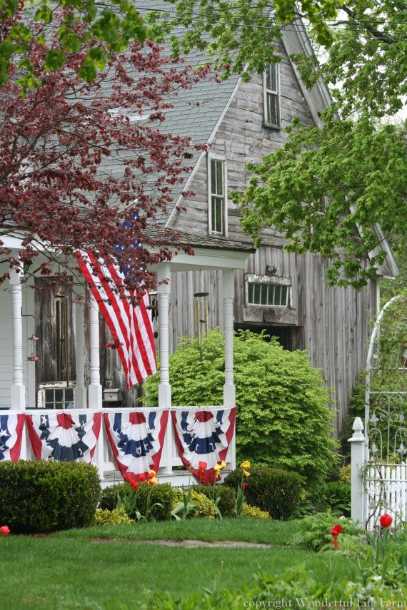 Patriotic Old Weathered Farmhouse...with flags and buntings.