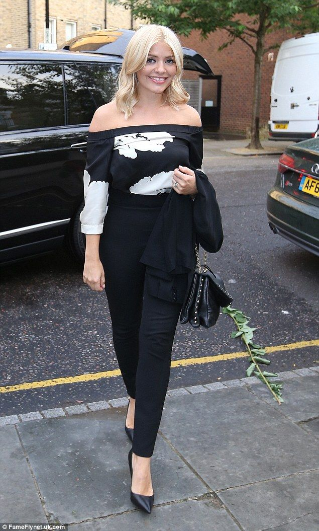Dressed to impress: Holly slipped into a black and white Bardot top and spray-on black tro...