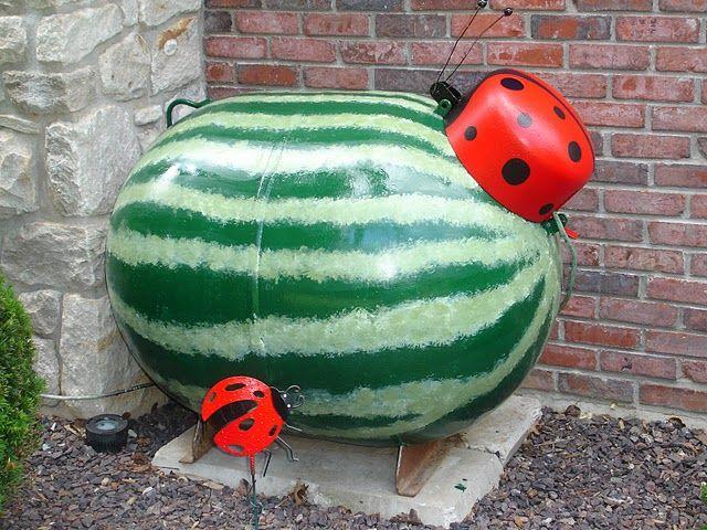 Watermelon propane tank with ladybug cap. Yep, I painted it.