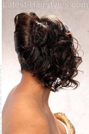 French Roll Hairstyle With Curls