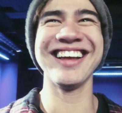 Calum hood smiling with teeth