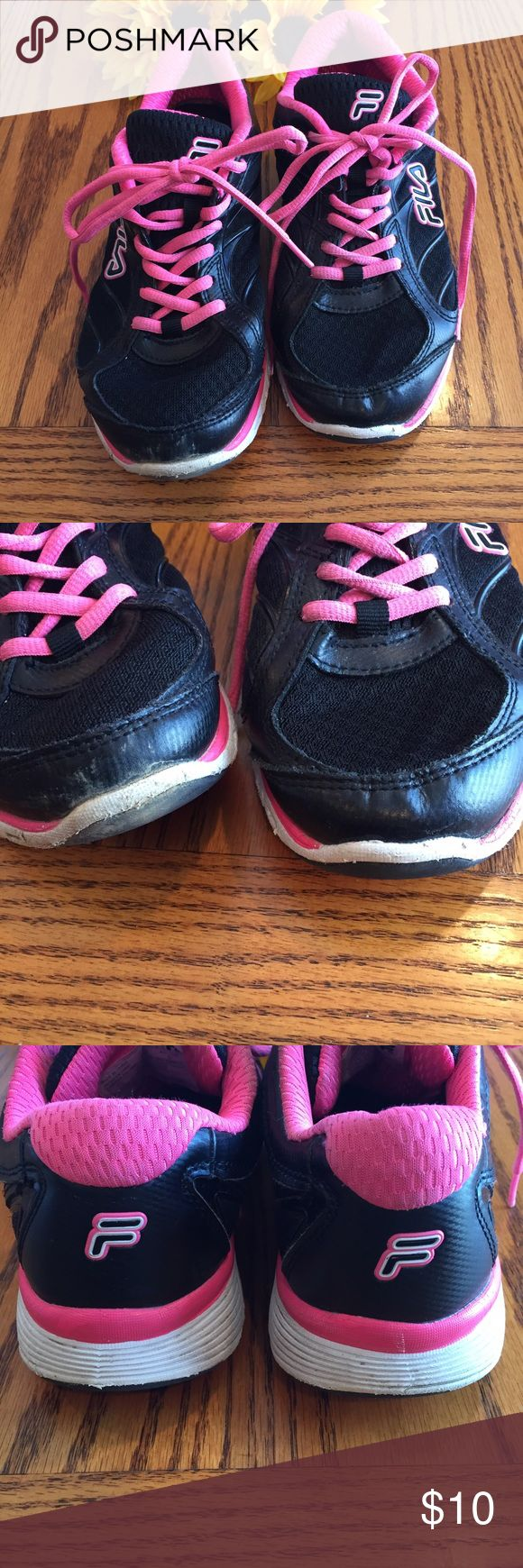 Fila Pink and black sneakers   Size 7 1/2 Fila Pink and black sneakers   Size 7 1/2. Worn but a lot of life left. Fila Shoes Sneakers