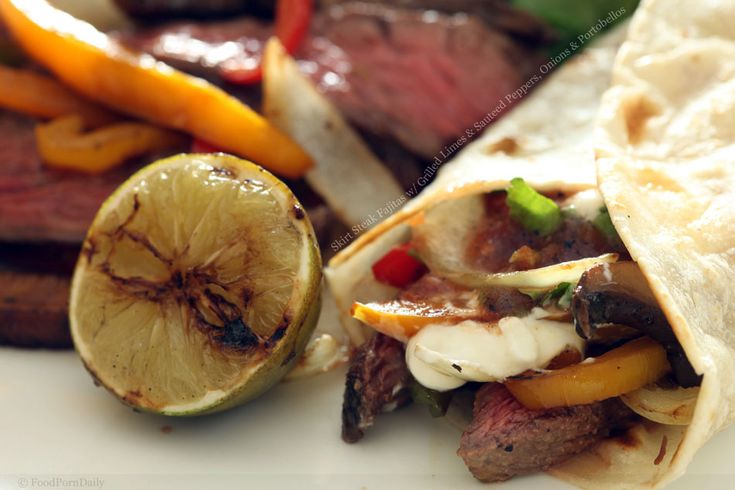 grilled skirt steak fajitas with grilled limes and sauteed peppers ...