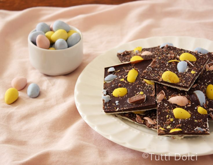Cadbury Easter Egg Bark - the petite pastel eggs have become a weakness. While eating the eggs out of hand satisfied me for a day or two (I love how the candy shell shatters, giving way to solid milk chocolate), I became determined to create another use for them; thus, the evolution of Cadbury Easter Egg bark. Chopped Cadbury Mini Eggs sit atop two layers of smooth, melt-in-your-mouth chocolate for absolute chocolate heaven.