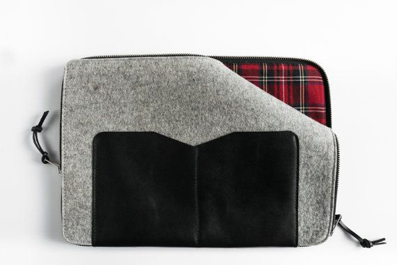 You can find more pictures here https://www.facebook.com/MrArtigiano/  This minimalis leather sleeve with wool felt, represents our focus on