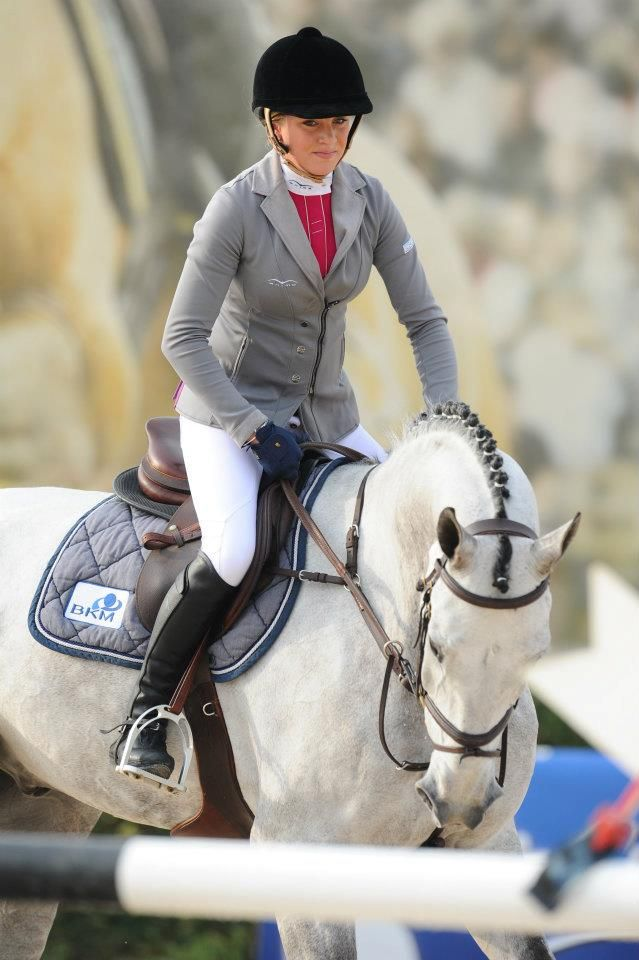 Olivia Hamood, the Australian rider, in her grey Animo show-jumping jacket and colored shirt combination, with matching saddle pad!