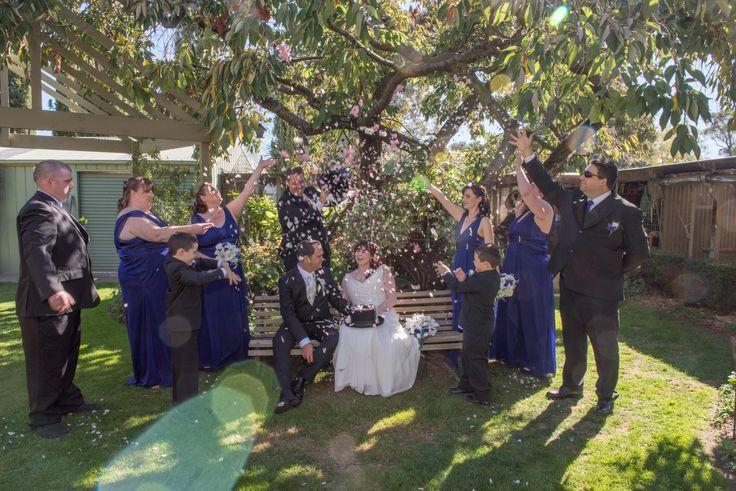 Candid Photos of a Lifetime - a shower of rose petals at the beautiful Gairloch Garden, Oberon  Gairloch Garden Oberon is the perfect location for wedding formals. www.candidphotosofalifetime.com.au