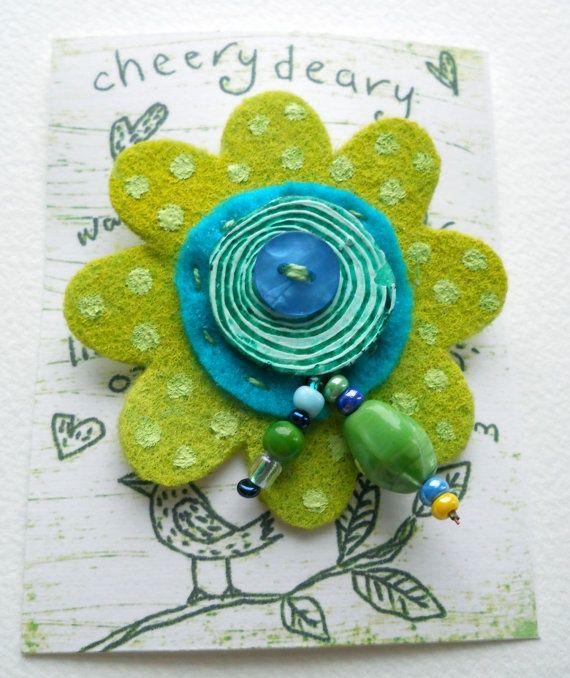 felt and bead brooch.: