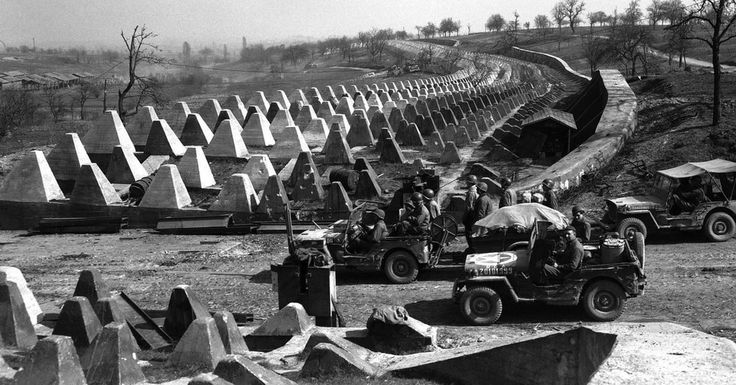 Hitler's Fortified Siegfried Line Was Massive And Included 22,000 Bunkers And Pillboxes    Soldiers of the US 7th Army pause at the Siegfried Line on the road to Karlsruhe, Germany, 27 March 1945