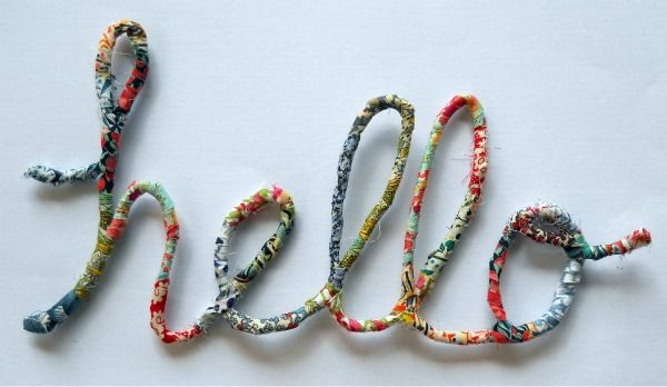 A fabric wrapped wire 'hello' by @Nova Flitter