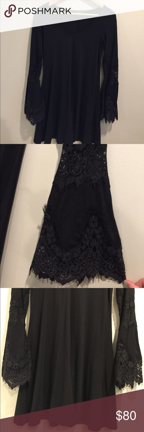 Express flare sleeve lace dress Black long sleeve flowy dress. Likely worn, perfect condition. Size is XS but fits like a small/medium. Express Dresses Long Sleeve
