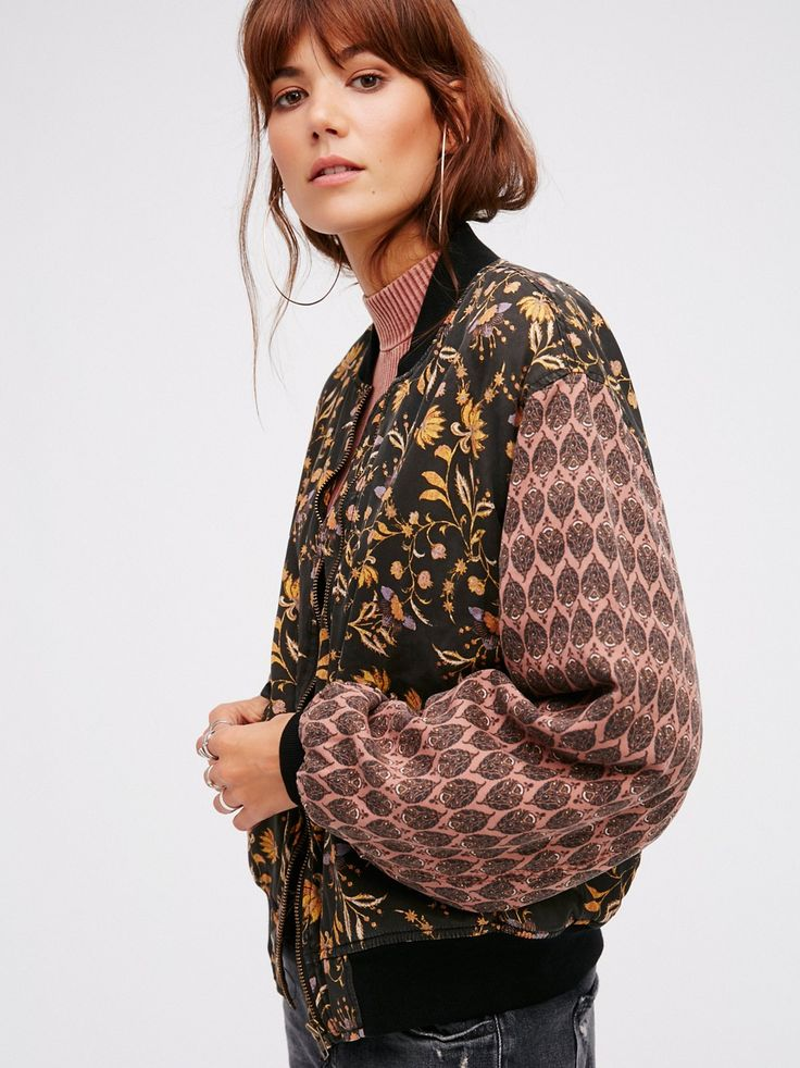 Daytrip Printed Bomber Jacket | Classic bomber silhouette featuring contrast patterns and designs. Front zip closure and hip pockets with snap closures. Silky quilted lining.