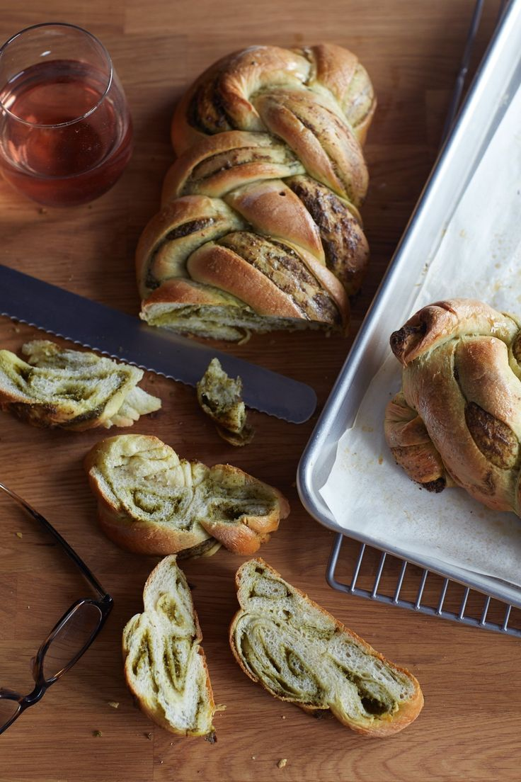 This is a bread to impress. Impress your family or guests with the beautiful braids and striations. Impress them with an invitingly complex fragrance of yeast and herbs. Impress them with delicate texture. Impress them most of all with the powerful burst of spring pesto that ripples throughout this bread. If you're up for an afternoon of baking, add this gorgeous loaf to your weekend to-do list.