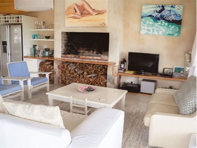 The Ocean Villa is situated in the quaint village of Sandbaai, a stone's throw away form Hermanus.   The lavish Mediterranean home comprises of four bedrooms and three bathrooms. There is a fully equipped kitchen, a lounge, and a dining room which leads onto a covered balcony upstairs. Downstairs there is a kitchenette, a lounge with DStv, a laundry, and a garden with a patio. The abode also offers guests a swimming pool, Wi-Fi Internet access, braai facilities and parking on the premises.