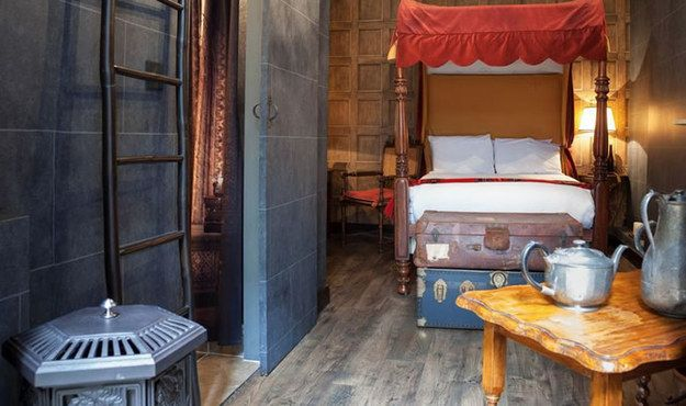 The gothic-looking rooms are decked out with four-poster beds, spellbooks, cauldrons, potion bottles, and even school trunks.