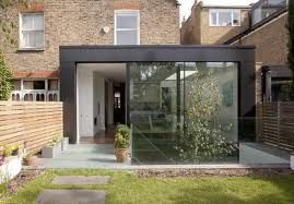 Dark steel frame of extension - contrast between old and new