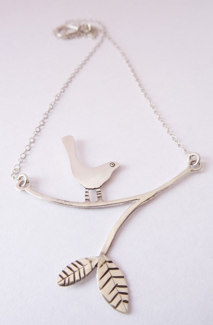 Stripey legs, recycled sterling silver bird on a branch. by ClaireAllainDesigns on Etsy