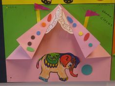 Dr. Seuss activities:  LOVE how they folded a square of construction paper to make a circus tent!  Perfect for Seuss' If I Ran The Circus story.  Could put a writing prompt inside, or write about their favorite thing at the circus on the back and then illustrate it on the front.