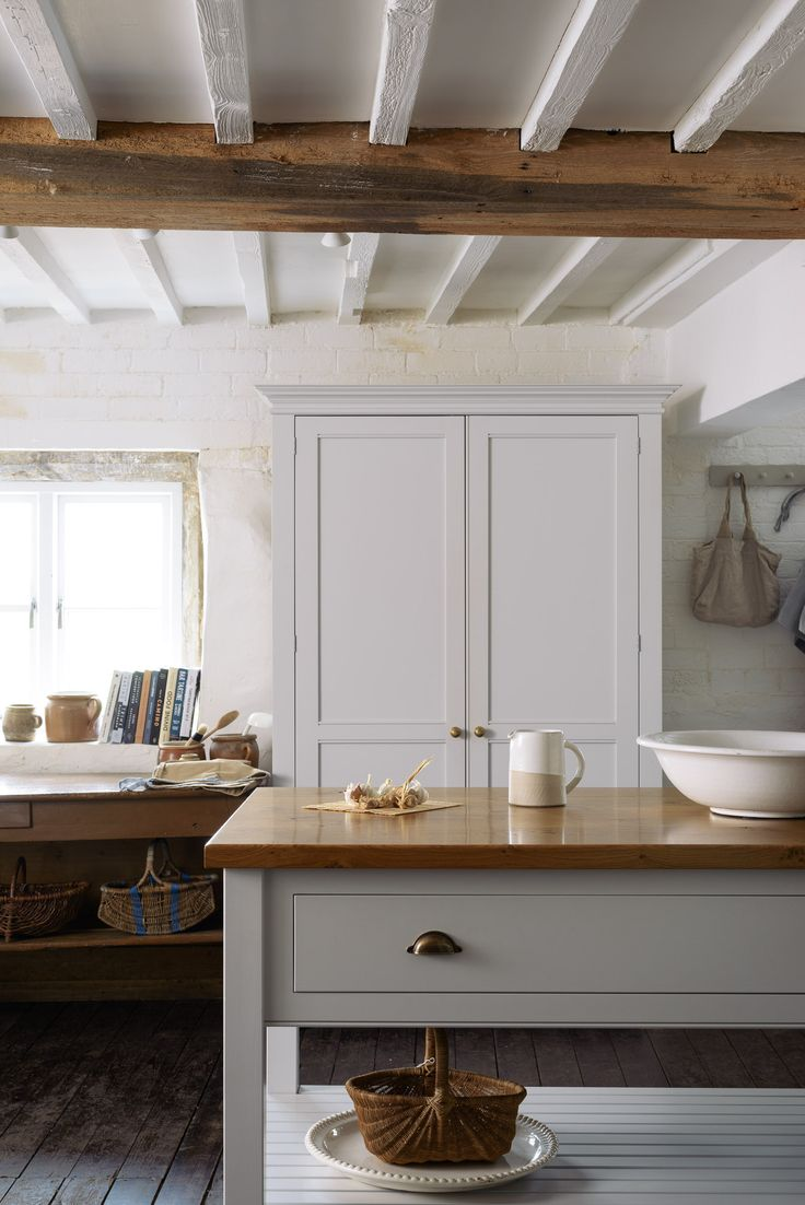 Cotes Mill has ample space to show off our beautiful long Classic Prep Table with brass cup handles. Painted in soft muted colours, this beautifully serene kitchen celebrates traditional English handmade furniture.