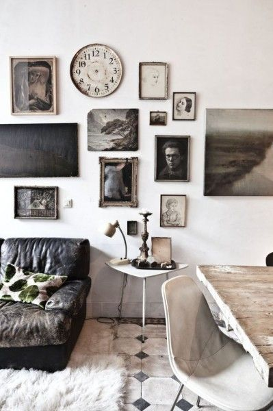 A collection of vintage photo's is displayed beautifully in this gallery wall