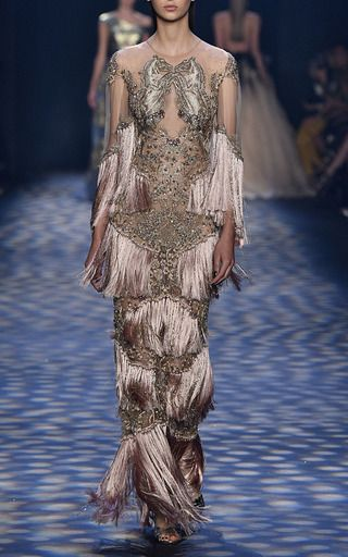 This **Marchesa** gown features rose gold threadwork, fringe detailing, and crystal embroidery.
