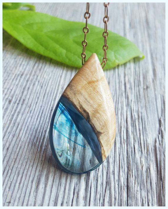 Drop of Ocean resin and wood pendant necklace, antiqued brass chain. #blue #ocean #jewelry
