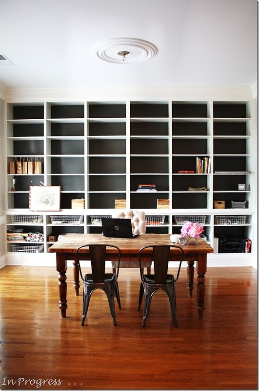 Like the bookshelves with dark background...paint is called Urbane Bronze by Sherwin Williams