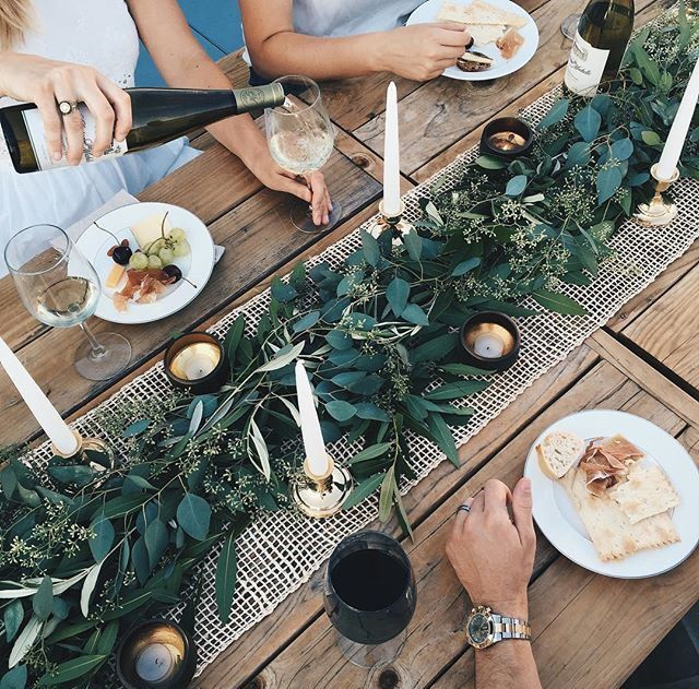 Close-up of greenery gathering table.
