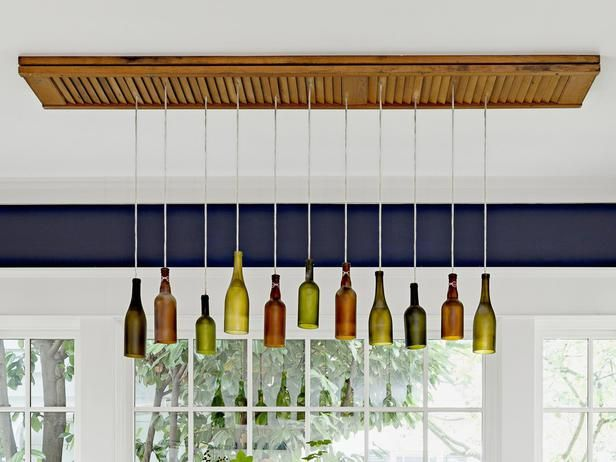 Handmade chandelier of repurposed beer and wine bottles hanging from an old bifold door #DIY #hgtvmagazine http://www.hgtv.com/kitchens/go-green-with-a-recycled-kitchen/pictures/page-4.html?soc=pinterest