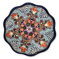 NOVICA Talavera ceramic serving plate, 'Wilderness' by NOVICA. $34.49. Unique like a kaleidoscope this Talavera design is by Pedro Alba in Mexico. A colorful flower takes the center its petals reaching toward the scalloped border of this serving plate. Alba continues to use the hand-crafting process of Talavera ceramics that was brought to Mexico in the 16th century. Talavera is a type of majolica ceramics distinguished by the use of cobalt blue over an off-white background.