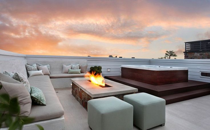Contemporary Hot Tub with Outdoor seating, Concrete floors, Threshold square patio ottoman, Fire pit, Smooth ledge firescape