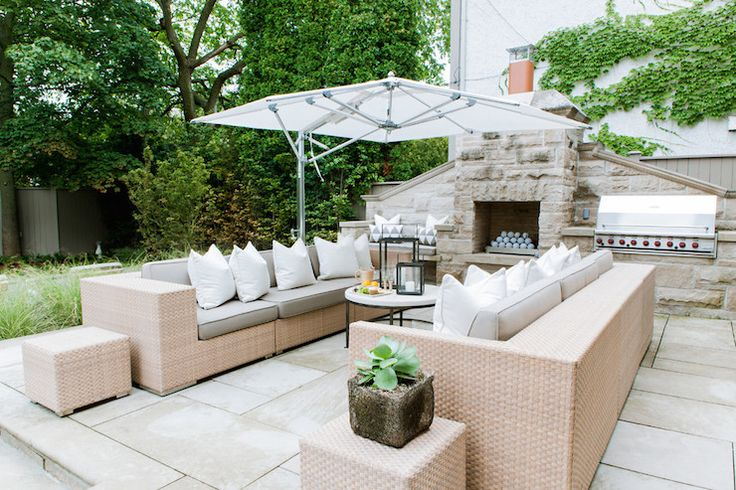 Beautiful patio feature a stone outdoor fireplace flanked by a built-in bench to the left and built-in bbq to the right.