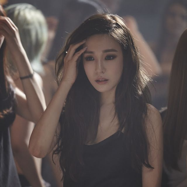 Official pictures from SNSD Tiffany's 'Heartbreak Hotel' MV