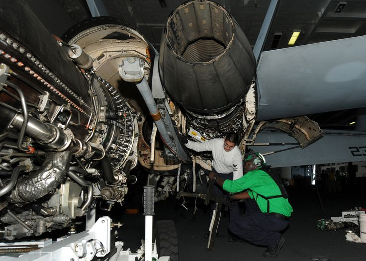US_Navy_100821-N-2686K-011_Aviation_Machinist's_Mate_2nd_Class_Kevin_M._Kaleda_perform_maintenance_on_an_F-A-18F_Super_Hornet_in_the_hangar_bay_aboard_USS_George_H.W._Bush_(CVN_77).jpg (2100×1500)