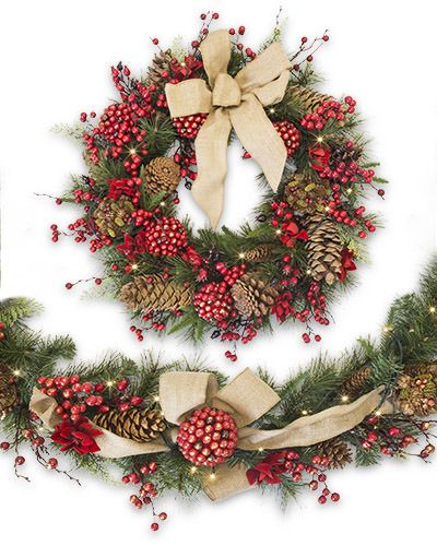 The Aspen Berry Wreath and Garland are each decorated with ornaments made of red berries washed in gold glitter and red velvet blossoms for a delightful blend of texture.